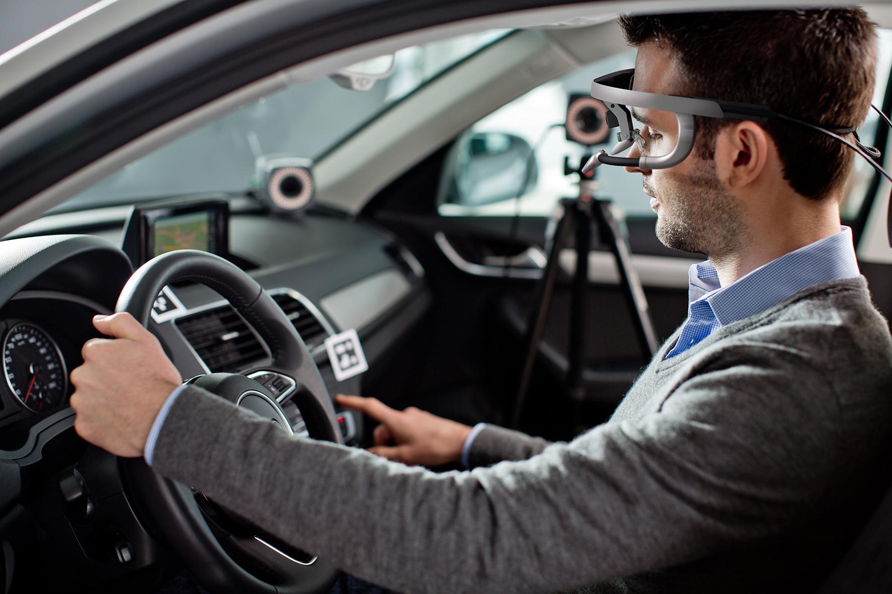Man in a car wearing eye-tracking glasses
